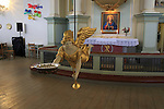 Golden angel figure and altar inside historic Nykirken church, city of Bergen, Norway