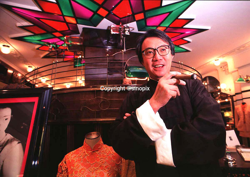 210597: DAVID TANG: HONG KONG<br /> <br /> Hong Kong businessman and socialite, David Tang, poses in his Hong Kong fashion house Shanghai Tang in Central District Hong Kong.<br /> <br /> PHOTO BY RICHARD JONES / SINOPIX