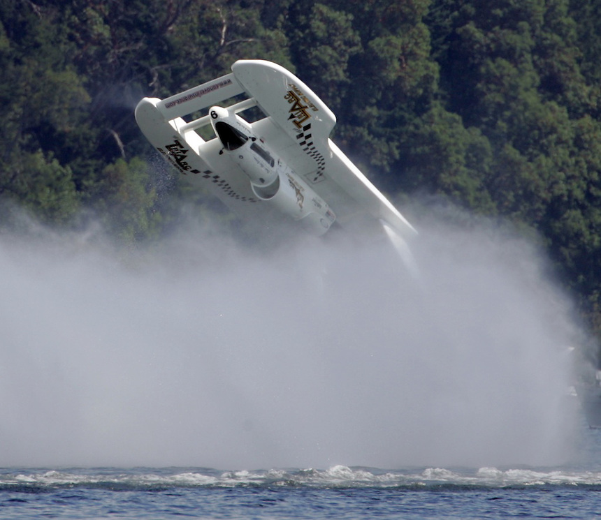 The Miss Tri Arc Electric driven by Chris Bertrum flips in turn one at the start of Heat 1B of Chevrolet Cup at Seafair on Lake Washington in Seattle on Saturday, August 4, 2007. Bertrum was not injured but the boat was out of the competition for the day. (AP Photo/Kevin P. Casey)