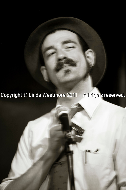 Ryan Keonig, washboard, harmonica and vocals.  American group, Pokey LaFarge and the South City Three, play riverboat soul at the Blue Coconut Club, Pulborough, Sussex.