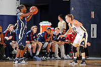21 January 2012:  FAU guard-forward DaLita Scott (13) handles the ball while being defended by FIU guard Zsofia Labady (3) in the second half as the Florida Atlantic University Owls defeated the FIU Golden Panthers, 50-49, at the U.S. Century Bank Arena in Miami, Florida.