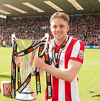 Lincoln City's Callum Howe with the trophy<br /> <br /> Photographer Andrew Vaughan/CameraSport<br /> <br /> Vanarama National League - Lincoln City v Macclesfield Town - Saturday 22nd April 2017 - Sincil Bank - Lincoln<br /> <br /> World Copyright &copy; 2017 CameraSport. All rights reserved. 43 Linden Ave. Countesthorpe. Leicester. England. LE8 5PG - Tel: +44 (0) 116 277 4147 - admin@camerasport.com - www.camerasport.com