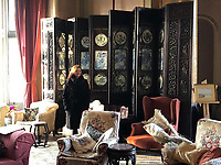BNPS.co.uk (01202 558833)<br /> Pic: PhilYeomans/BNPS<br /> <br /> The screen in situ in Gilford Castle in Northern Ireland...<br /> <br /> This impressive, giant Chinese screen covered in exquisite porcelain has sold for £75,000.<br /> <br /> The 20ft by 10ft late Qing dynasty-era antique, which can be folded 12 times, would traditionally have been used to divide up large spaces and provide privacy.<br /> <br /> It has hardwood panels bordered by various fruits and flowers with figures of dragons carved into it.<br /> <br /> Attached to the screen are blue and white porcelain plaques showing idyllic landscape scenes.