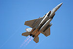 An F-15 Eagle from the Oregon Air National Guard's 142nd Fighter Wing streaks skyward with afterburners on. Departing Nevada's Stead Field in September, 2007, the aircraft were grounded in November of 2007 when a manufacturing defect in the longeron of the early models was discovered after a Missouri Air National Guard F-15 broke apart in flight. Photographed 09/07