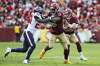 Landover, MD - November 18, 2018: Washington Redskins quarterback Colt McCoy (12) follows Washington Redskins tight end Vernon Davis (85) during the  game between Houston Texans and Washington Redskins at FedEx Field in Landover, MD.   (Photo by Elliott Brown/Media Images International)