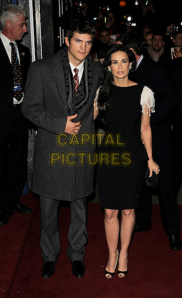 """ASHTON KUTCHER & DEMI MOORE.UK Film Premiere of """"Flawless"""" at the Odeon Covent Garden, London, England. .November 26th, 2008.full length black dress married husband wife grey gray coat jacket white sleeves beads beaded pattern scarf  open toe shoes .CAP/CAN.©Can Nguyen/Capital Pictures."""