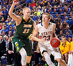 SIOUX FALLS, SD - MARCH 10: Reed Tellinghuisen #23 from South Dakota State drives past A.J. Jacobson #21 from North Dakota State in the first half of the Summit League Championship Tournament game Tuesday at the Denny Sanford Premier Center in Sioux Falls, SD. (Photo by Dave EggenInertia)