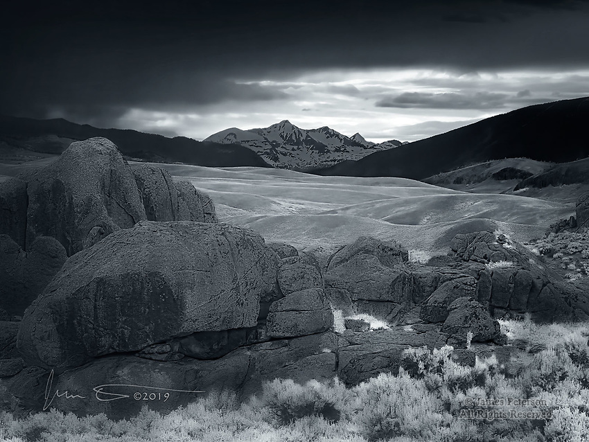 View from Hartman Rocks (Infrared).  Just south of Gunnison, Colorado, this area of rugged boulders and twisted pines is full of gnarly trails that are popular among mountain bikers.  But on a stormy day, it also has some very dramatic views of its natural beauty and its mountainous surroundings.  <br /> <br /> Image ©2019 James D Peterson
