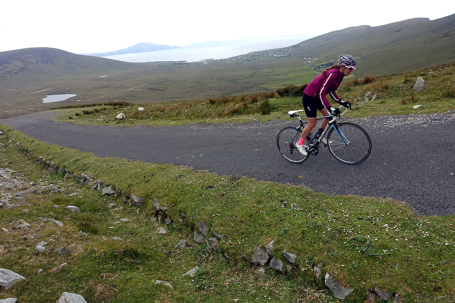 Cycling up the steep slopes of Minaun Heights, County Mayo, Achill Island, Ireland.