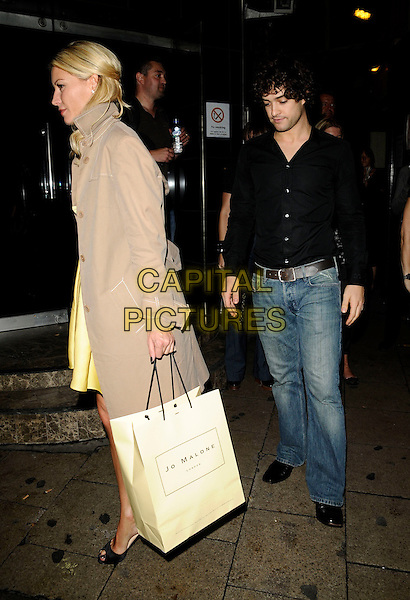 "DENISE VAN OUTEN & LEE MEAD.The ""Hairspray: The School Musical"" gala show, Lyric Theatre, London, England..August 31st, 2008.full length black shirt jeans denim profile beige mac trench coat couple jo malone bag .CAP/CAN.©Can Nguyen/Capital Pictures."