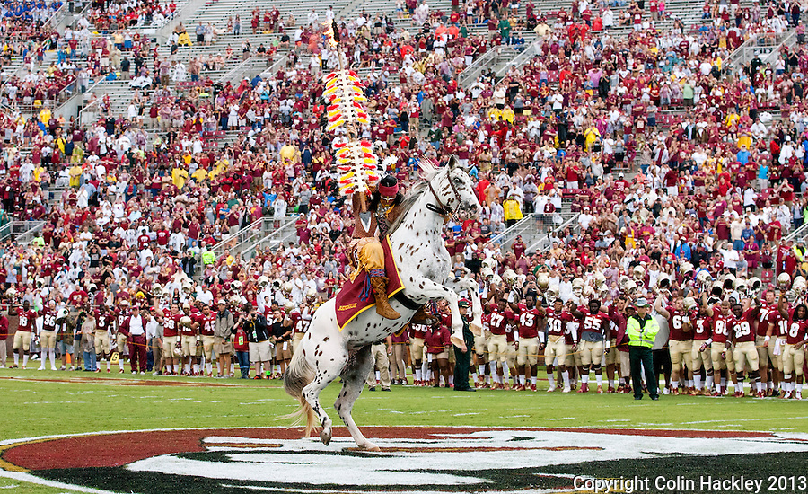 TALLAHASSEE, FLA 9/21/13-FSU-BCC092113CH-Osceola, portrayed by Florida State University student Drake Anderson, plants the spear at midfield before the Bethune-Cookman game Saturday at Doak Campbell Stadium in Tallahassee. <br /> COLIN HACKLEY PHOTO