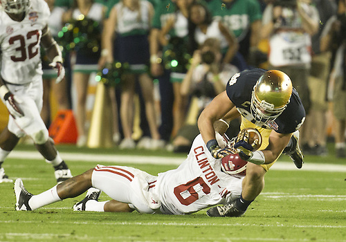January 7, 2013:  Alabama defensive back Ha'Sean Clinton-Dix (6) tackles Notre Dame tight end Tyler Eifert (80) during the Discover BCS National Championship between the Alabama Crimson Tide and the Notre Dame Fighting Irish at Sun Life Stadium in Miami Gardens, Florida.  Alabama defeated Notre Dame 42-14.