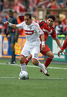 16 May 09: Chicago Fire midfielder Cuauhtemoc Blanco #10 and Toronto FC forward Pablo Vitti #8 in action at BMO Field during a game between the Chicago Fire and Toronto FC. Chicago Fire won 2-0..
