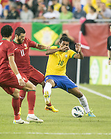 Brazil midfielder Paulinho (18) holds off Portugal midfielder Vieirinha (11).  In an International friendly match Brazil defeated Portugal, 3-1, at Gillette Stadium on Sep 10, 2013.