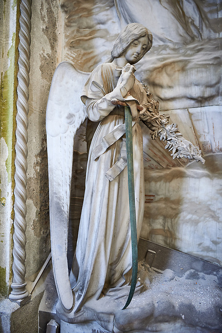 Picture and image of the stone sculpture of Margherita Capurro ascending to heaven while her husband grieves, 1901.  The monumental tombs of the Staglieno Monumental Cemetery, Genoa, Italy