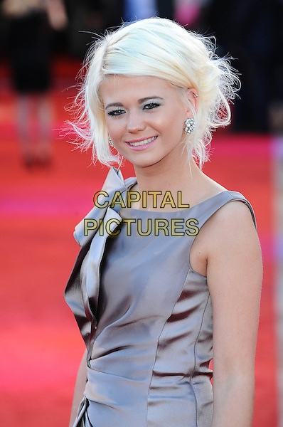 "Danielle Harold.The UK Premiere of ""Cowboys And Aliens"", O2 Arena, London, England..11th August 2011.half length beige grey gray silk satin dress   . CAP/BEL.©Tom Belcher/Capital Pictures."