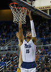 Nevada forward Trey Porter (15) dunks the ball against California Baptist in the first half of an NCAA college basketball game in Reno, Nev., Friday, Nov. 16, 2018. (AP Photo/Tom R. Smedes)