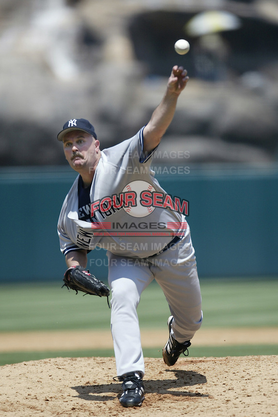 David Wells of the New York Yankees pitches during a 2002 MLB season game against the Los Angeles Angels at Angel Stadium, in Anaheim, California. (Larry Goren/Four Seam Images)