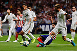 Diego Costa of Atletico de Madrid and Raphael Varane (L) and Nacho Fernandez (R) of Real Madrid during La Liga match between Atletico de Madrid and Real Madrid at Wanda Metropolitano Stadium{ in Madrid, Spain. {iptcmonthname} 28, 2019. (ALTERPHOTOS/A. Perez Meca)
