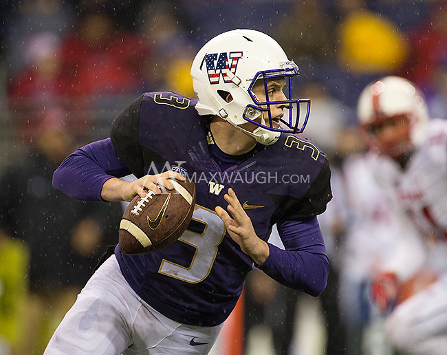 Jake Browning rolls out to pass.