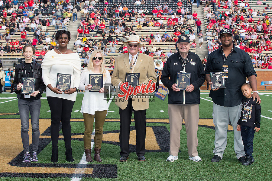 (L-R) Annie Bersagel (track & cross country), Tracy Connor (women's basketball), Kelly Dostal (field hockey), George Greer (baseball head coach), Stan Najeway (men's basketball) and Fred Robbins (football) were honored at half-time of the football game against the North Carolina State Wolfpack as the newest members of the Wake Forest Sports Hall of Fame at BB&T Field on October 24, 2015 in Winston-Salem, North Carolina.  (Brian Westerholt/Sports On Film)