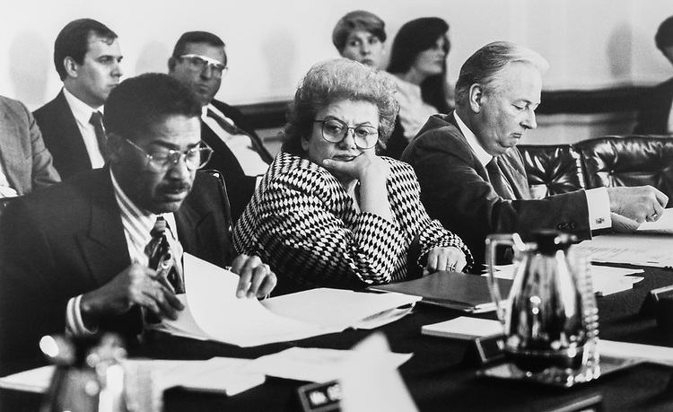 Rep. Bill Clay, D-Mo., Rep. Mary Rose Oakar, D-Ohio, and Rep. Al Swift, D-Wash., (with staffers in the background) on March 2, 1992. (Photo by Maureen Keating/CQ Roll Call)