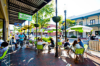 Sidewalk diners enjoy a sunny Saturday on Palafox Street in downtown Pensacola.<br /> <br /> <br /> COLIN HACKLEY PHOTO