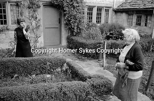 Upper Slaughter, Gloucestershire 1975. England.<br /> <br /> Mrs Kirkland and Mrs Lepage