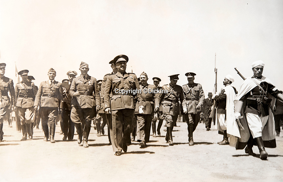 BNPS.co.uk (01202 558833)<br /> Pic: Dickins/BNPS<br /> <br /> Field Marshal Wolfram von Richthofen marching benind General Franco during the Spanish civil War.<br /> <br /> The unseen personal photo album of Field Marshal Wolfram von Richthofen, cousin to the legendary Red Baron, which gives an unprecedented insight into his military career in the Third Reich, has been rediscovered.<br /> <br /> Wolfram served in the Red Baron's squadron in the WW1, went on to design the 'Jericho trumpet' of the infamous Stuka Bomber between the wars, before leading the Condor Legion in the Spanish Civil War.<br /> <br /> After the outbreak of WW2 the fascinating album shows Richthofen's lead roll in Operation Barbarossa - the Nazi's suprise invasion of Communist Russia and their race to conquer the vast country before the onset of the notorious Russian winter.<br /> <br /> The two albums were taken from Berlin by a British soldier at the end of the Second World War who kept it for 60 years before it was passed into the hands of a private collector.<br /> <br /> Dickins auctions are selling the historic albums with a £20,000 estimate on 31st March.
