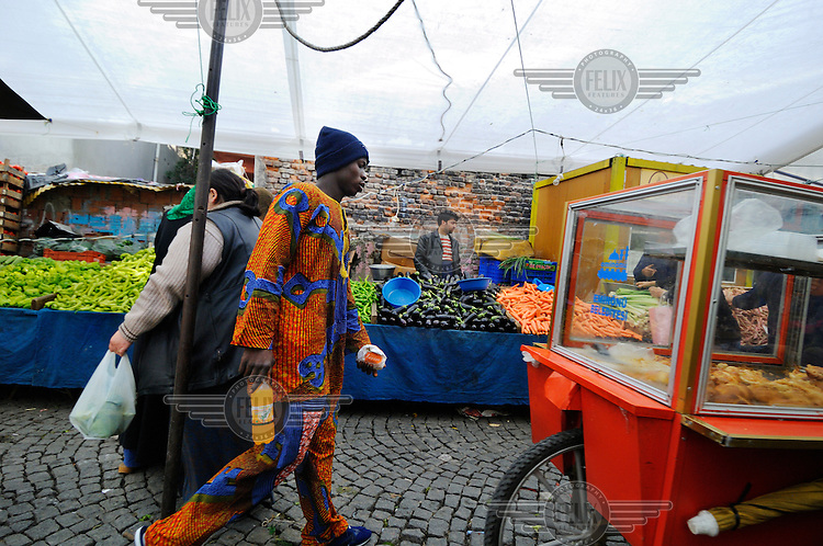 An African man at the weekly market in Kumkapi District, an area with many cheap lodgings for traders and migrants from developing countries, many of whom use Istanbul as a staging post for travelling on illegally into Europe