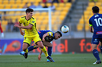 Phoenix's Liberato Cacace tackles Central Coast Mariners' Jair during the A-League football match between Wellington Phoenix and Central Coast Mariners at Westpac Stadium in Wellington, New Zealand on Saturday, 4 January 2020. Photo: Dave Lintott / lintottphoto.co.nz