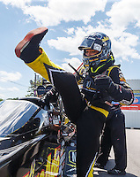 Jun 6, 2016; Epping , NH, USA; NHRA top fuel driver Leah Pritchett climbs into her car during the New England Nationals at New England Dragway. Mandatory Credit: Mark J. Rebilas-USA TODAY Sports