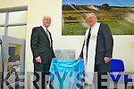 Board of Management members Mr David Ward and Canon John O'Shea unveiling a comerative plaque at  the official opening of Drumtrasna NS, Abbeyfeale last Friday..