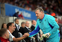 Ferrie Bodde of Swansea (L) greets Roger Freestone (R) during the Alan Tate Testimonial Match, Swansea City Legends v Manchester United Legends at the Liberty Stadium, Swansea, Wales, UK