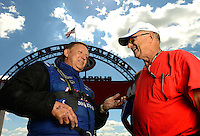 Sept 8, 2012; Clermont, IN, USA: NHRA pro stock driver Larry Morgan (left) talks with V. Gaines during qualifying for the US Nationals at Lucas Oil Raceway. Mandatory Credit: Mark J. Rebilas-