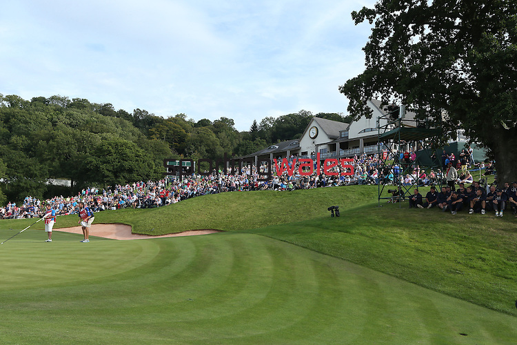 ISPS Handa Wales Open 2013<br /> General view of spectators surrounding the 18th green in front of the Twenty Ten clubhouse.<br /> 01.09.13<br /> <br /> &copy;Steve Pope-Sportingwales