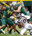 09/17/11-- Oregon defensive tackle Taylor Hart sacks Missouri State quarterback Trevor Wooden in the first half at Autzen Stadium in Eugene, Or....Photo by Jaime Valdez. ..............................................