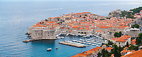 Panoramic photo of Dubrovnik Harbor and Old Town, Dalmatian Coast, Croatia, Europe. This is a panoramic photo of Dubrovnik Harbor and Old Town. It shows Dubrovnik Harbor and Dubrovnik Old Town jutting out into the Adriatic Sea on the Dalmatian Coast of Croatia. By far the best views of Dubrovnik are from elevated hills such as Zarkovica Hill.