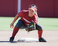 NWA Democrat-Gazette/CHARLIE KAIJO An Arkansas Razorbacks player catches the ball during a softball match, Sunday, October 28, 2018 at Bogle Park, University of Arkansas in Fayetteville.<br />