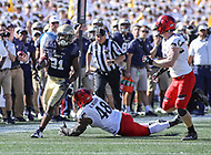 Annapolis, MD - September 23, 2017: Navy Midshipmen running back Tre Walker (21) avoids Cincinnati Bearcats defensive end Kevin Mouhon (48) during the game between Cincinnati and Navy at  Navy-Marine Corps Memorial Stadium in Annapolis, MD.   (Photo by Elliott Brown/Media Images International)