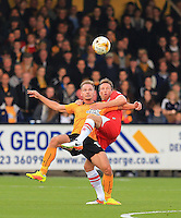 Adam McGurk fends off another Grimsby attack during the Sky Bet League 2 match between Cambridge United and Grimsby Town at the R Costings Abbey Stadium, Cambridge, England on 15 October 2016. Photo by PRiME Media Images.
