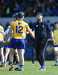 John Conlon of Clare is commiserated with by Dan Shanahan, Waterford selector following their National League game against Waterford at Cusack Park. Photograph by John Kelly.