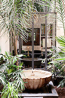 Simple water features are set amongst the exotic plants of the riad's courtyard