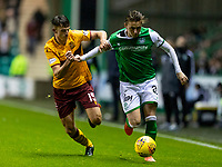 23rd November 2019; Easter Road, Edinburgh, Scotland; Scottish Premiership Football, Hibernian versus Motherwell; Scott Allan of Hibernian and Barry Maguire of Motherwell compete for possession of the ball - Editorial Use
