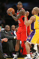 02/22/11 Los Angeles, CA: Atlanta Hawks guard Jamal Crawford #11 during an NBA game between the Los Angeles Lakers and the Atlanta Hawks at the Staples Center. The Lakers defeated the Hawks 104-80.