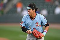 Left fielder Jonathan Ornelas (3) of the Hickory Crawdads warms up before a game against the Greenville Drive on Wednesday, May 15, 2019, at Fluor Field at the West End in Greenville, South Carolina. Greenville won, 6-5. (Tom Priddy/Four Seam Images)