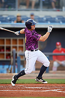 Charlotte Stone Crabs third baseman Kevin Padlo (11) follows through on a swing during a game against the Palm Beach Cardinals on April 21, 2018 at Charlotte Sports Park in Port Charlotte, Florida.  Charlotte defeated Palm Beach 5-2.  (Mike Janes/Four Seam Images)