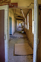 The 47th Field Hospital located at Fort Chaffee Arkansas, has been abandoned for many years. The medical complex at Fort Chaffee opened on December 7, 1941 (Pearl Harbor Day). The medical complex itself is an enormous site with 128 buildings all held together by long hallways. The complex has its own exchange and theater. It even had its own four lane bowling alley, not to mention being a 1,595 bed hospital.