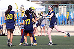 Santa Barbara, CA 02/18/12 - \m20\, Shelby Wagner (Michigan #17) and unidentified Michigan player(s) celebrate their 11-10 overtime victory against BYU at the 2012 Santa Barbara Shootout.