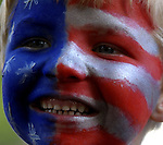 Andrew Szemreylo, 6, of Tolland, shows off his red, white and blue face painted by his mom Colleen,prior to  the kids parade during the annual July in the Sky celebration, Wednesday, July 3, 2013, in down Rockville.  (Jim Michaud / Journal Inquirer)